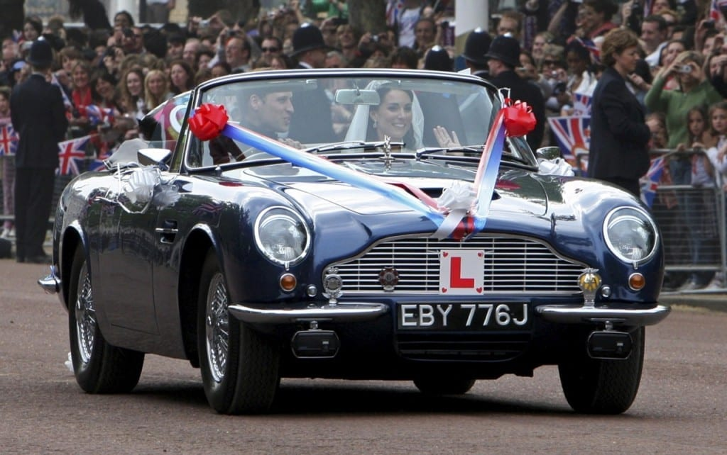 Britain's Prince William and his wife Catherine, Duchess of Cambridge drive from Buckingham Palace in an Aston Martin DB6 Mark 2, after their wedding in Westminster Abbey, in central London April 29, 2011. Prince William married his fiancee, Kate Middleton, in Westminster Abbey on Friday (ROYAL WEDDING/ BALCONY)   REUTERS/Yui Mok/Pool     (BRITAIN - Tags: ENTERTAINMENT SOCIETY ROYALS)